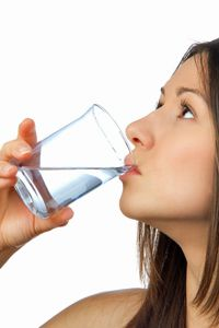 Water fasting woman drinks glass of water